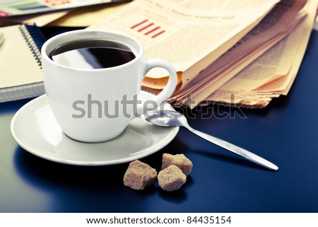 Business morning, coffee and newspaper