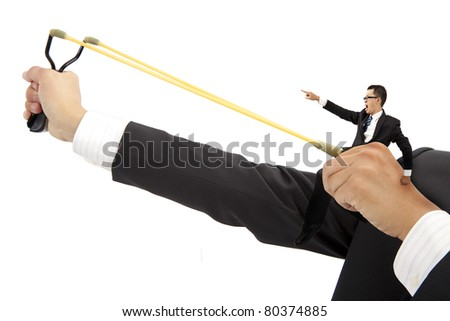 business motivate concept. businessman with slingshot and ready for launch
