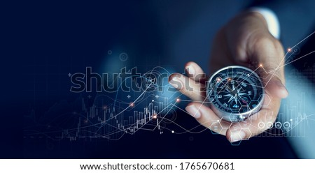 Business navigate recovery, Abstract, The compass navigate for businessmen to resume business growth in the economic crisis, Rethink, Reinvent and Recover. Foto stock ©