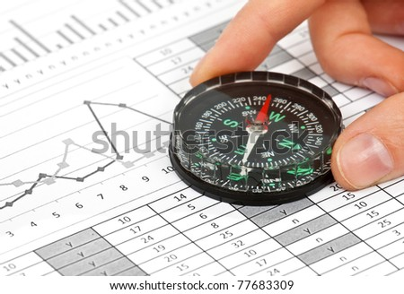 business navigation concept with compass and diagram or graph