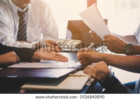 Business negotiation concept; Business people handshaking to sign contract of business at business meeting