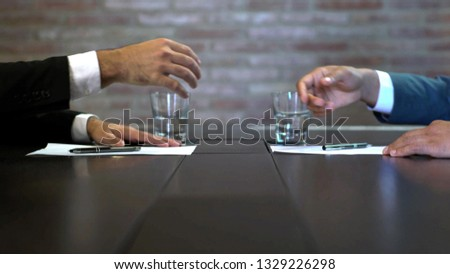 Business negotiations close up, two businessmen discussing analyzing financial data, male hand holding pen, convincing client to sign contract, emphasizing important information, negotiating skills -  #1329226298