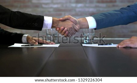 Business negotiations close up, two businessmen discussing analyzing financial data, male hand holding pen, convincing client to sign contract, emphasizing important information, negotiating skills -  #1329226304