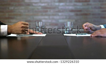 Business negotiations close up, two businessmen discussing analyzing financial data, male hand holding pen, convincing client to sign contract, emphasizing important information, negotiating skills -  #1329226310