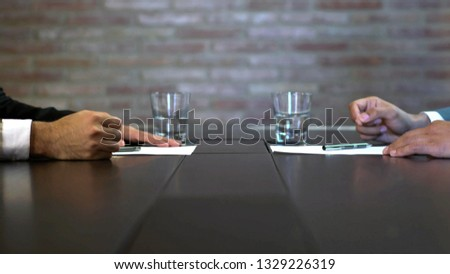 Business negotiations close up, two businessmen discussing analyzing financial data, male hand holding pen, convincing client to sign contract, emphasizing important information, negotiating skills -  #1329226319