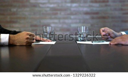 Business negotiations close up, two businessmen discussing analyzing financial data, male hand holding pen, convincing client to sign contract, emphasizing important information, negotiating skills -  #1329226322