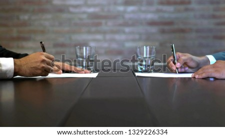 Business negotiations close up, two businessmen discussing analyzing financial data, male hand holding pen, convincing client to sign contract, emphasizing important information, negotiating skills -  #1329226334