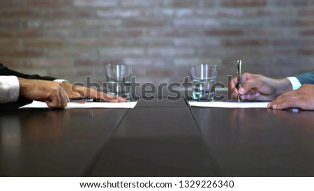 Business negotiations close up, two businessmen discussing analyzing financial data, male hand holding pen, convincing client to sign contract, emphasizing important information, negotiating skills -  #1329226340
