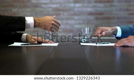 Business negotiations close up, two businessmen discussing analyzing financial data, male hand holding pen, convincing client to sign contract, emphasizing important information, negotiating skills -  #1329226343