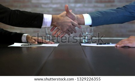 Business negotiations close up, two businessmen discussing analyzing financial data, male hand holding pen, convincing client to sign contract, emphasizing important information, negotiating skills -  #1329226355