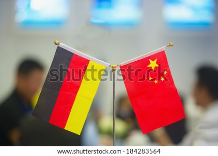 business negotiations: German and Chinese flags at the exhibition #184283564