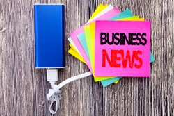 Business News. Business concept for Modern Online News written on sticky note with space on old wood wooden background with power bank