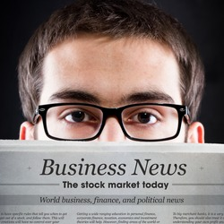 Business News. Young adult looking for daily news.