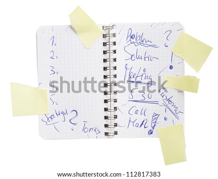 business notebook with scribbled notes, free copy space, isolated on white background