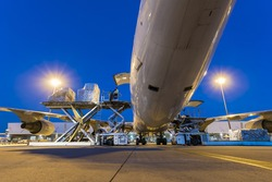 Business of air cargo freighter with import and export at twilight sky