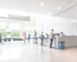 Business office building lobby blur background of bank reception hall customer or patient counter service and cashier desk inside blurry hospital, office or hotel waiting hall