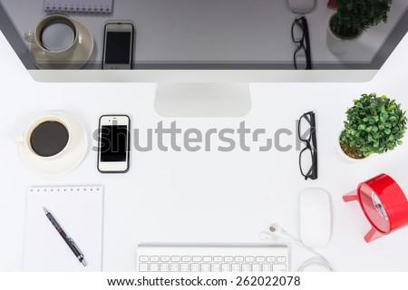 Business office top view computer monitor on white table