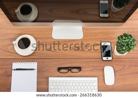 Business office top view computer monitor on wooden table