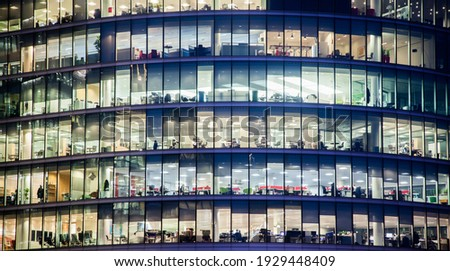 business office windows at night  Corporate building London City  England