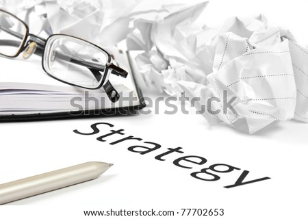 business or investment strategy concept with pen paper, notebook and glasses
