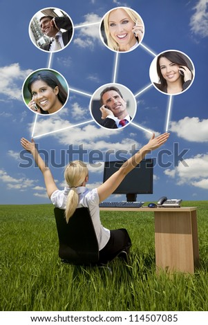 Business or social network connections concept photograph of woman businesswoman sitting at a desk using a computer in a green field raising her arms into a bright blue sky with fluffy white clouds - stock photo
