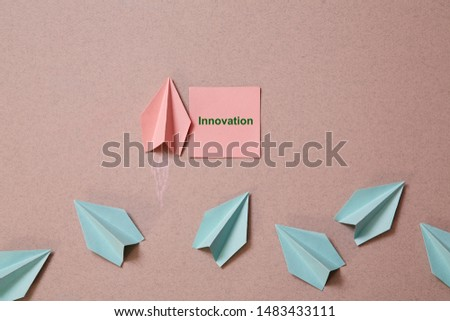 Business original idea, individuality and creativity. Success and motivation concept. Origami plane with sticker