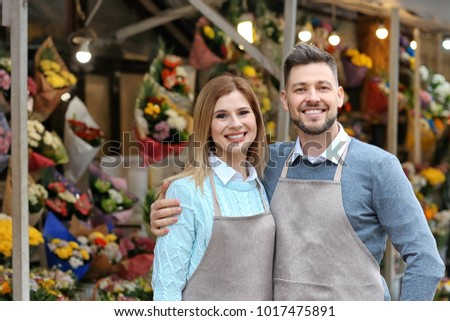 Business owner near their store with flowers