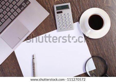 Business papers and a cup of coffee on the table