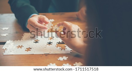Business partner trust together in team building. Solution puzzle solve strategy team building organize connections trust communication partnership. Hands of business trust team holding jigsaw puzzle