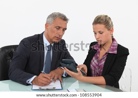 business partners calculating the budget