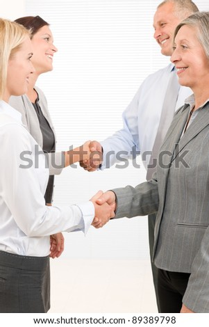 Business partners close successful deal happy people shaking hands agreement