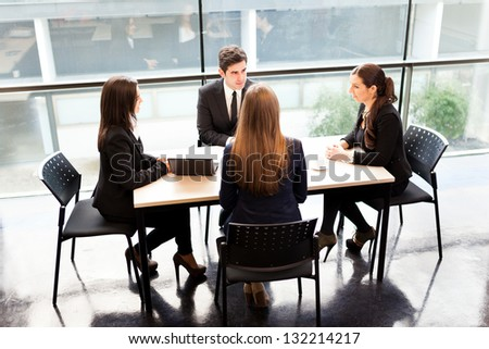 Business partners discussing ideas at meeting