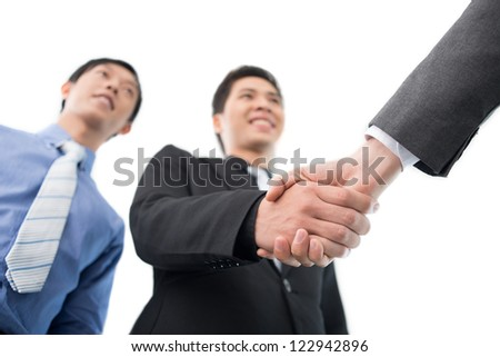 Business partners exchanging firm handshakes