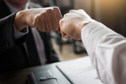 Business Partners Giving Fist Bump to  commitment Greeting Start up new project or complete mission successful deal together with strong teamwork. startup concept