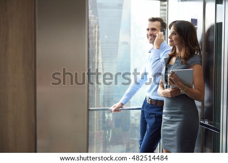 Business partners in the elevator