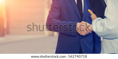 Business partners, man and woman handshake. Business concept. New team members. Stock photo ©