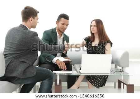business partners shake hands after signing the contract #1340616350
