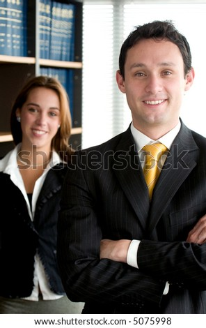 Business partners smiling in an office - man and woman