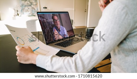 Business partners using laptop for a online meeting on video call. Businesswoman working from home making video call to business partner using laptop.