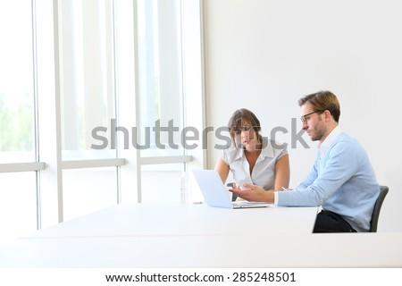 Business partners working on project, copyspace