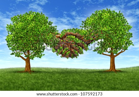Business partnership growth success with two growing green trees in the shape of two hands hand shaking together as a financial symbol of agreement and contract between two companies or business men.