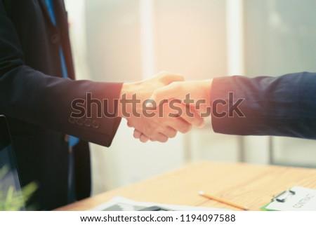 Business partnership marketing meeting concept. Image businessmans handshake. Successful businessmen handshaking after good deal.Discussing Together Startup Idea.Working Online Project,vintage color