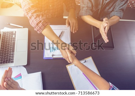 Business partnership marketing meeting concept. Image businessmans handshake. Successful businessmen handshaking after good deal.vintage color, Discussing Together Startup Idea.Working Online Project #713586673