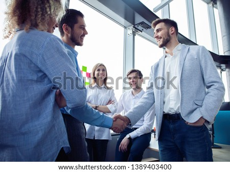 Business partnership meeting concept. Businessmen handshake. Successful businessmen handshaking after good deal #1389403400