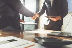 Business partnership meeting concept. Image businessmans handshake. Successful businessmen handshaking after good deal. Group support concept.