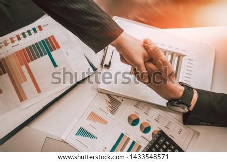 Business partnership meeting concept. Image businessmans handshake. Successful businessmen handshaking after good deal. Group support concept