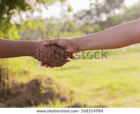 Business partnership meeting concept. Image handshake. Successful businessmen handshaking after good deal. Horizontal, blurred background