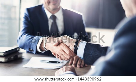 Business partnership meeting in office