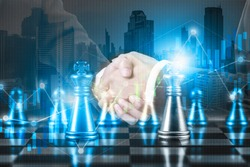 Business partnership successful and strategic plan concept ,  Double exposure businessman handshake on financial market stock chart with chess board game competition