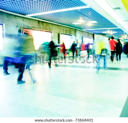 Business passenger at subway station at intentional motion blurred